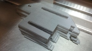 CNC punched sheet metal blank waiting to be folded
