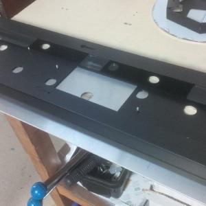 Folded lighting housing manufactured from black anodised aluminium sheet metal