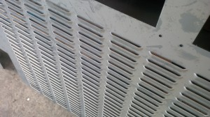 Ventilation louvres in sheet metal panels