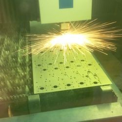 Laser cutting sheet metal in action