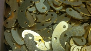 Laser cut brass clamping strips