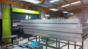 Large folded stainless steel sheet metal trays