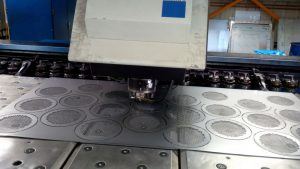 Trumpf 3000R CNC punch press in action producing circular sheet metal panels with cluster and curved banana tooling