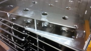 Stainless steel front panels with pressed inserts