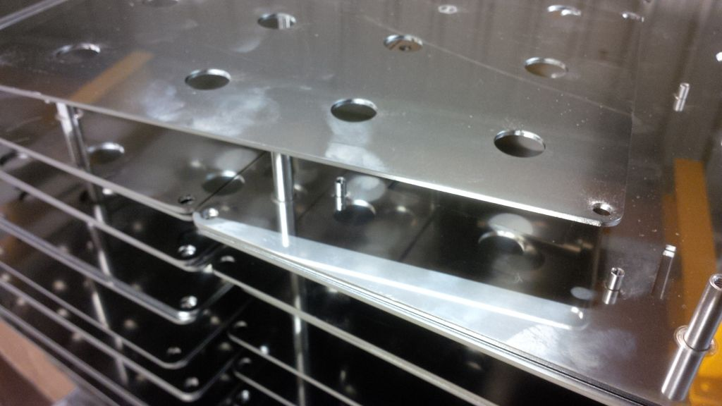 Sheet metal components manufactured with pressed inserts