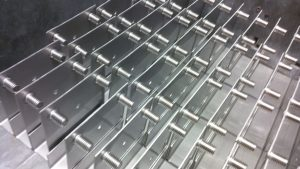 Pressed insert studs in sheet metal panels