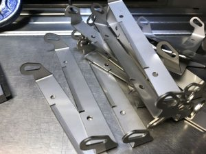 Laser cut and folded stainless steel brackets