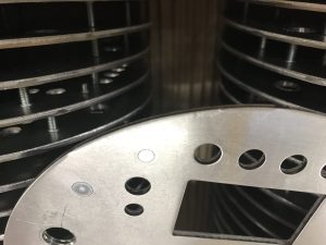 Close up of component produced using a CNC punch press banana tool