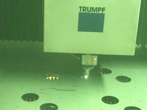Laser cutting sheet metal electronics enclosures
