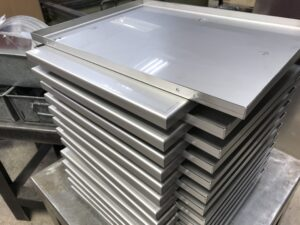 Sheet metal production of stainless steel trays