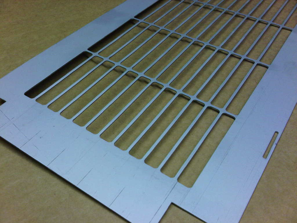 CNC punched zintec mild steel grille produced with bespoke punch press tooling